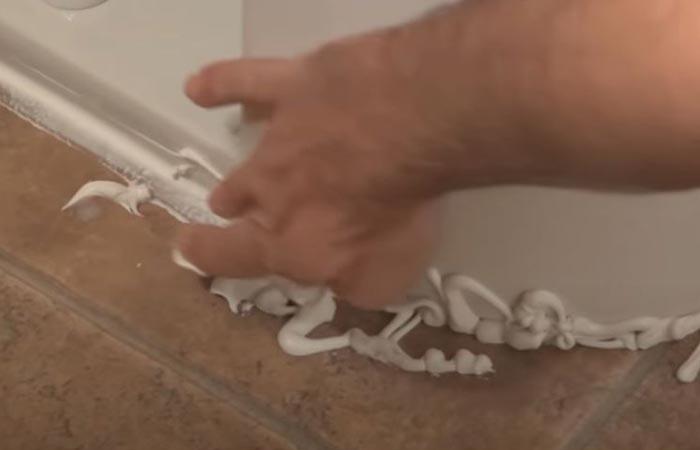 Applying Caulk Toilet Base