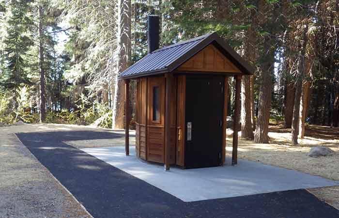 timber-made Vault Toilet